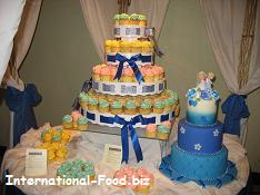 Three-tiered Wedding Cake and Cupcakes with Icing